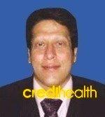 Dr. Chris E De D'souza