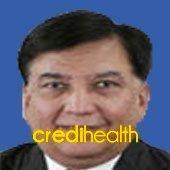 Dr. Navin R Davda